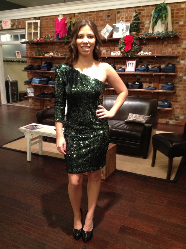 Haley is wearing: Blaque Label, One Shoulder Sequin Dress in Dark Olive, $108