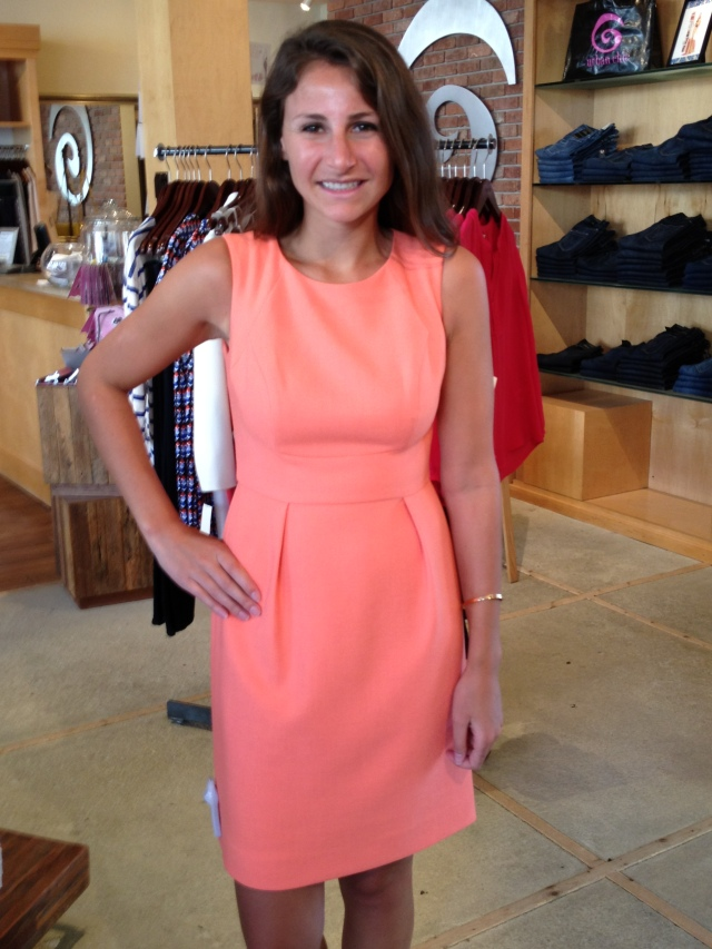 Hilly is wearing: Shoshanna, Eryn Dress in Neon Coral, $350.